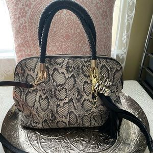 Cole haha snakeskin purse 👛